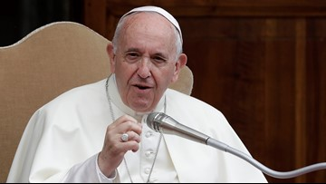 Pope Francis apologizes after slapping woman's hand when she yanks his arm