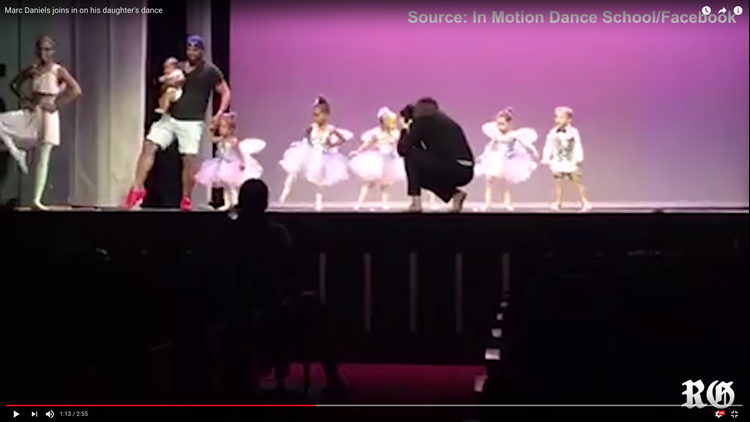 """The dad who rescued his crying, scared daughter onstage is dubbed """"Daderina"""" by the Internet."""