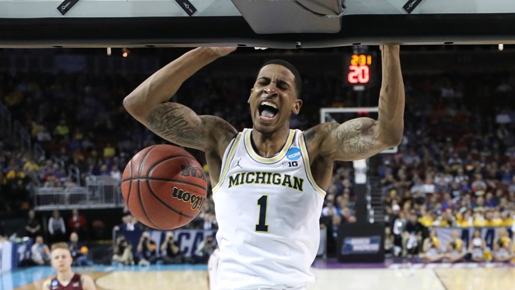 Charles Matthews of the Michigan Wolverines dunks the ball against the Montana Grizzlies during the first round of the 2018 NCAA Men's Basketball Tournament at INTRUST Arena on March 15, 2018 in Wichita, Kansas. Photo by Jeff Gross/Getty Images