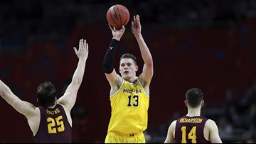 Michigan earns berth in title game with 69-57 win over Loyola Chicago