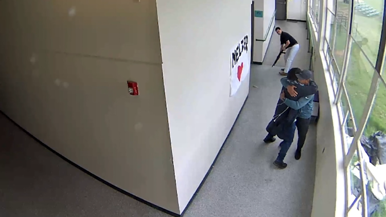 Watch: Powerful video shows Oregon football coach hugging student moments after disarming him