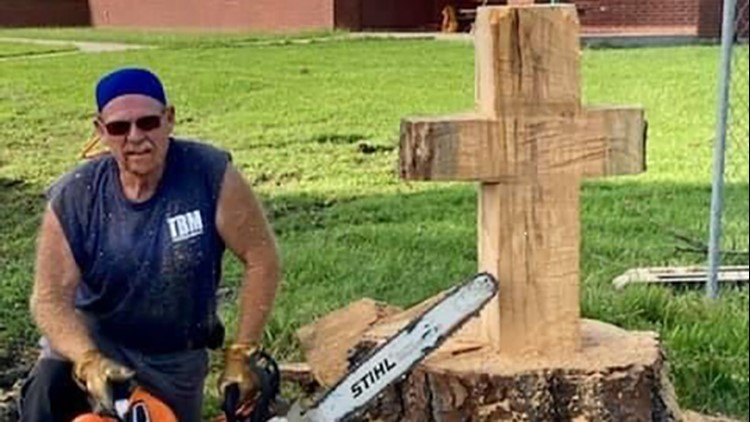 'Constant reminder of God's love'   Volunteer carves cross from tree downed by Hurricane Laura