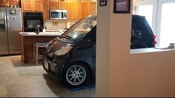 Jacksonville man parks Smart car in kitchen so it won't blow away