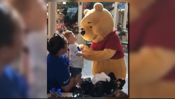 Winnie the Pooh melts hearts by caring for child with disabilities at Disney World