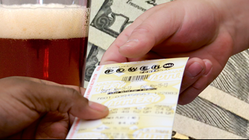 Cheers! A bartender cashes in on a $50K Powerball ticket tip