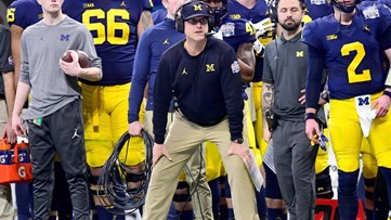 WATCH: Jim Harbaugh has awkward exchange with coach after Peach Bowl blowout