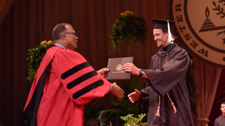 Red Wings player graduates from Western Michigan University