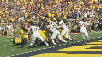 Michigan holds on to beat Army 24-21 in 2 overtimes