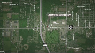 Deputies searching for suspect in armed robbery