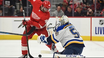 David Perron scores in OT to lift Blues past Red Wings, 5-4