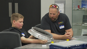 Machinery company's mentor program hosts special day for Kentwood students