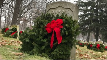 Volunteers lay hundreds of wreaths at Grand Rapids Home For Veterans Cemetery