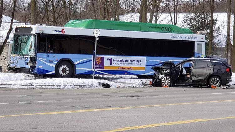 Woman killed in crash involving Rapid bus