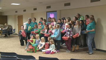 Grand Rapids girls pack shoeboxes full of gifts
