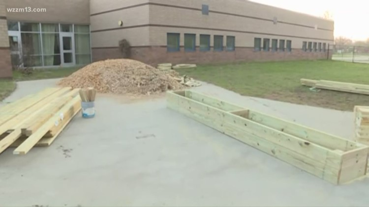 Holland community comes together to build greenhouse for students