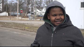 Muskegon Heights boy rewarded for pothole work