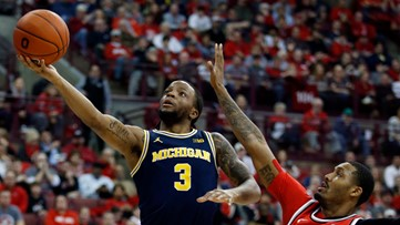 No. 23 Buckeyes surge late to beat No. 19 Michigan 77-63