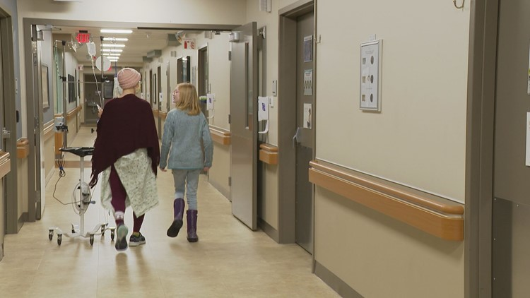 Brynn walks with a cancer patient.