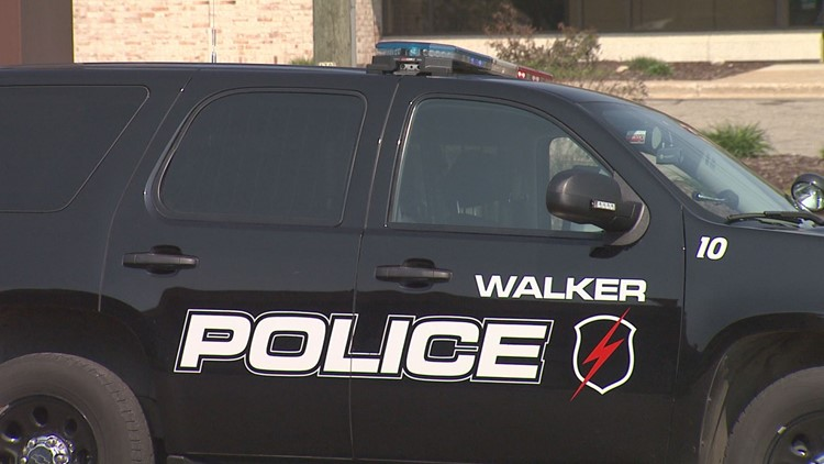 A fatal motorcycle crash late Wednesday morning forced authorities to close down a busy intersection in Walker.