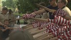 Scouts, volunteers places flags on graves for Memorial Day