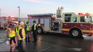 Fire trucks carrying candy canes bring cheer to UP town