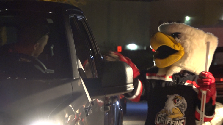 Griffins hold drive-thru teddy bear toss during delayed season