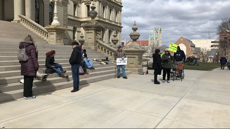 A small group rallied for chronic pain patients in Lansing Saturday.
