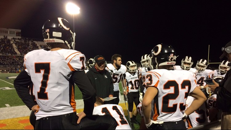 Rockford varsity football coach Ralph Munger retires