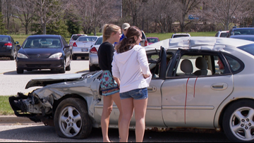 Police simulate a car crash to remind students to drive safely during prom season