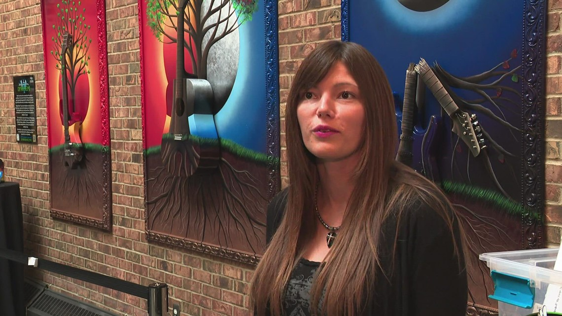 ArtPrize entry 'Deeply Rooted' utilizes spray paint, guitars to represent phases of life
