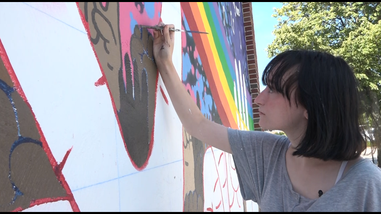 Spring Lake students paint murals around the village