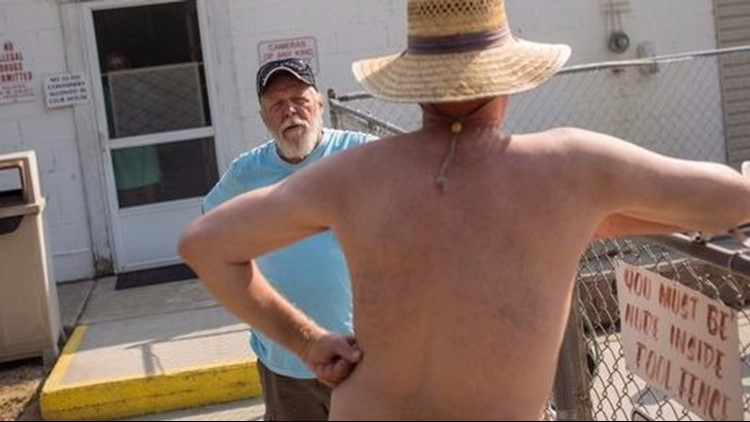 Cherry Lane Nudist Resort owner Dennis Bevis, 66, talks with a resident  outside of