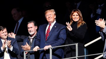 Trump soaks in cheers at college football matchup