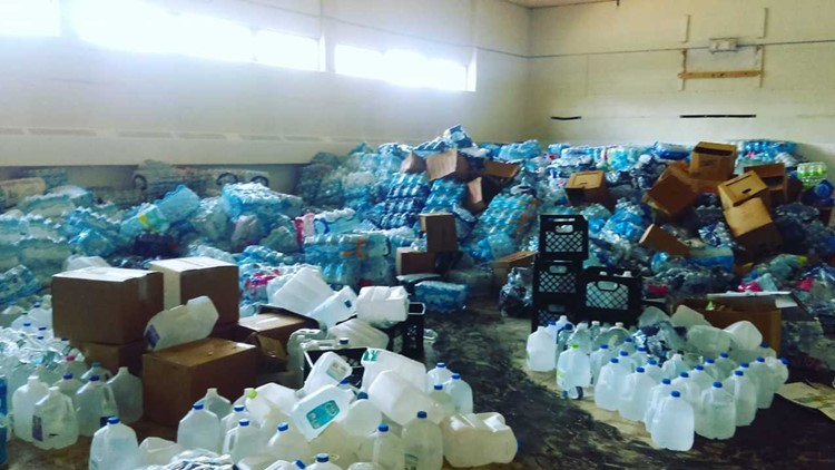 Cases of donated water found in old Flint school