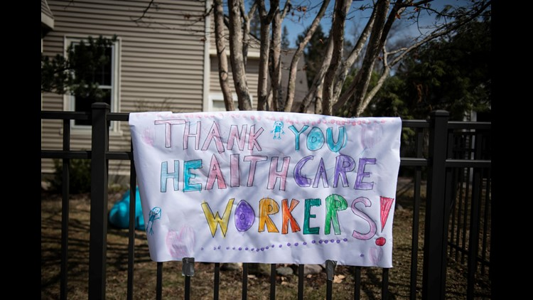 Neighborhood showcases a big sign of support of health care workers