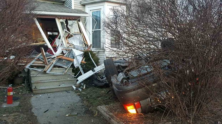 Car rolls over, crashes into house in Grand Haven
