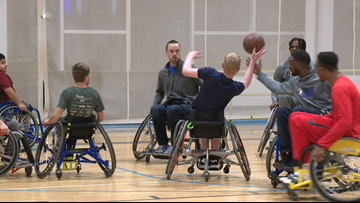 Grand Rapids Drive players join wheelchair basketball team practice