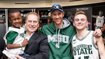 Boy who invited class to adoption hearing celebrates Big 10 win with MSU
