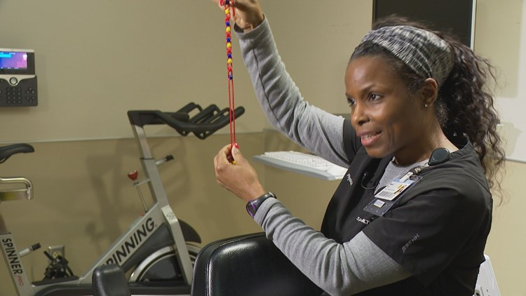 Physical therapist Bonita Neil shows how the beads work.