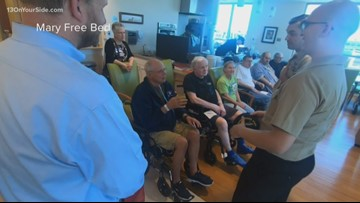 Navy officers spend time with veterans at Mary Free Bed