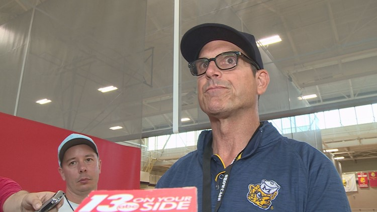 Harbaugh comes to Schembechler's defense