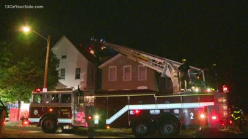 Crews spend hours fighting Grand Rapids house fire