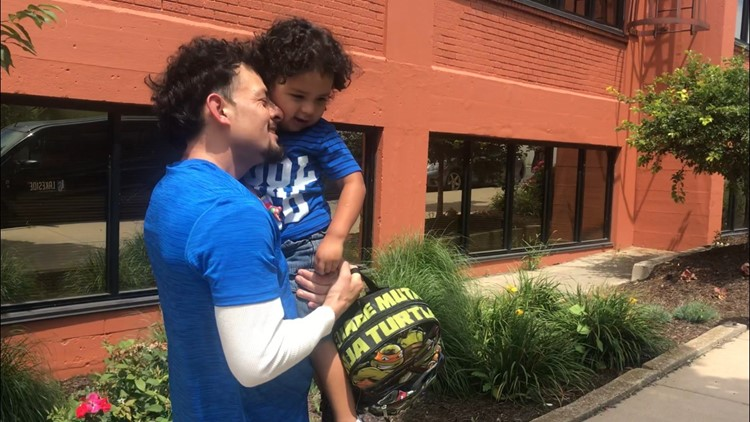 detained father reunited with son in grand rapids