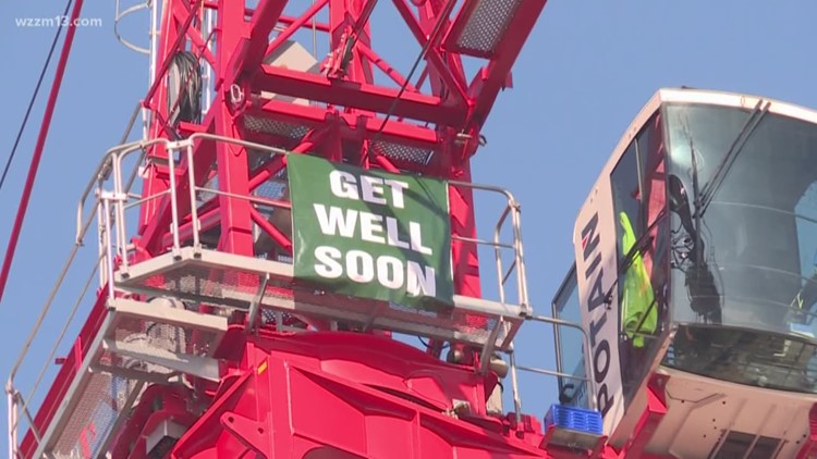 Patient at Spectrum's Heart Center gets well wishes from nearby crane