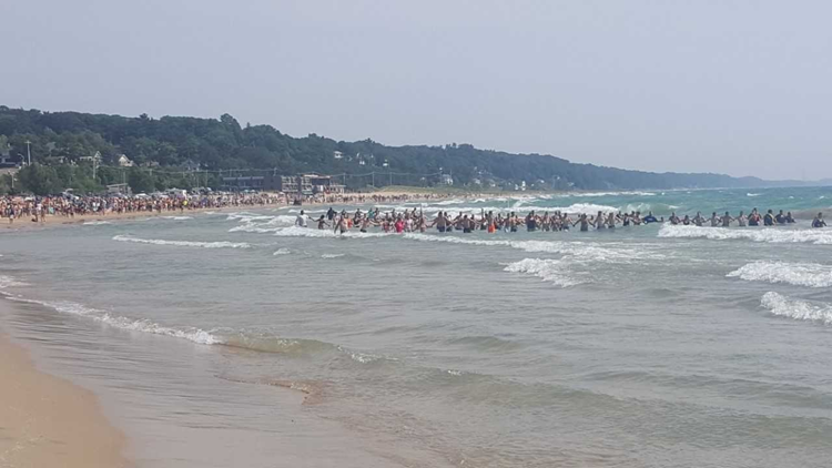 Water rescue in Grand Haven, human chain