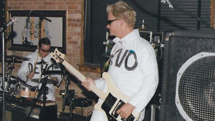 Steve Secor with his lefty Rickenbacker bass guitar.