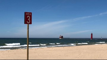 Beach safety signs up in Grand Haven to aid first responders