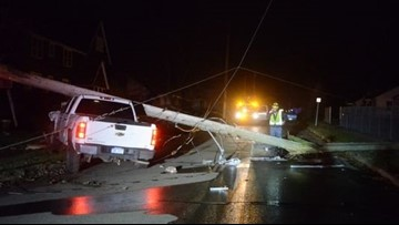 Driver arrested after pickup strikes power pole