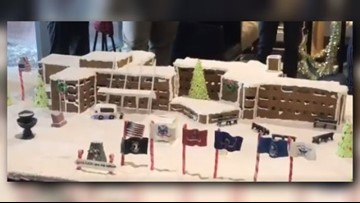 Students gift Grand Rapids Home for Vets a gingerbread replica of facility