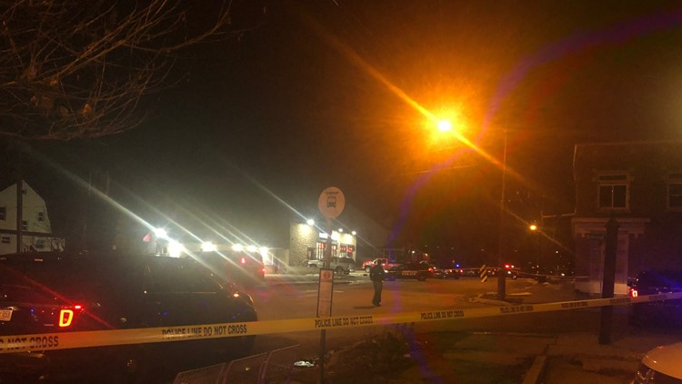 Shooting scene at Miss Tracy's Liquor Store